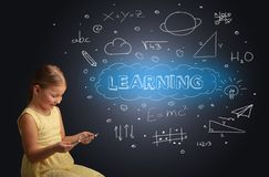 Little kid using on tablet with educational concept royalty free stock photography