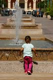 Little Kid Watching And Having Fun Royalty Free Stock Photo