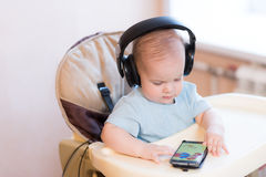 Little kid watching a cartoon on the phone Stock Photo