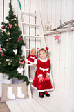 Little kid wearing as Santa Claus Royalty Free Stock Images