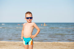 Little kid wearing fashion sunglasses on the beach Royalty Free Stock Photography