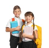 Little kids with backpacks and notebooks. On white background. Stationery for school Royalty Free Stock Photo
