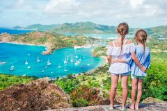 Little kids with beautiful famous view. View of English Harbor from Shirley Heights, Antigua, paradise bay at tropical. View of English Harbor from Shirley Royalty Free Stock Photography