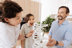 Little kids being excited about new DNA model Royalty Free Stock Photos