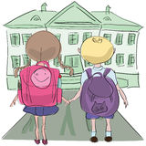 Little kids with big bags o their way to school Stock Photo