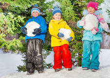 Little kids with big snowballs in the park Stock Image