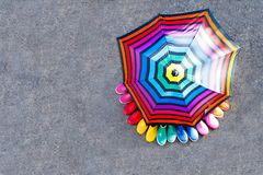 Little kids, boys and girls in colorful rain boots standing under umbrella. Royalty Free Stock Photo