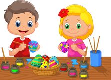 Little kids cartoon painting Easter egg Royalty Free Stock Images
