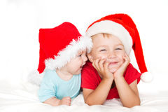 Little kids with christmas hats Stock Photo