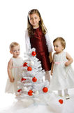 Little kids with a christmas tree Royalty Free Stock Image