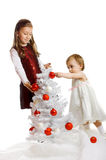 Little kids with a christmas tree Stock Photography
