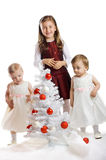 Little kids with a christmas tree Royalty Free Stock Photo