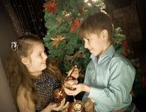 Little kids  decorate Christmas tree Stock Photo