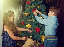 Little kids  decorate Christmas tree Royalty Free Stock Photography