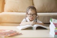 Little kids doing his homework Stock Images