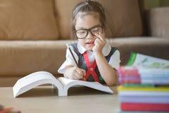 Little kids doing his homework Stock Photo