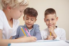 Little kids drawing at elementary school art class royalty free stock images