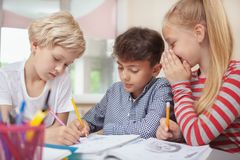 Little kids drawing at elementary school art class royalty free stock photos