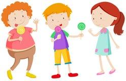Little kids eating lollipops Stock Photos