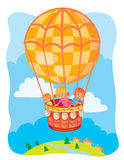 Little kids fly on the big air balloon Stock Images