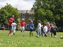 Little kids on football training in the park stock images