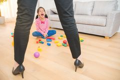 Little kids girl sad crying. Due to her mad crazy business women mother censure her behavior with messy living room toys are every at home royalty free stock photos