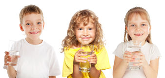 Little kids with a glass of water. Children with a glass of water isolated on white royalty free stock image