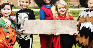 Little kids at a Halloween party stock images