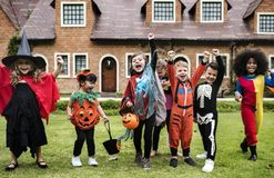 Little kids at a Halloween party royalty free stock images