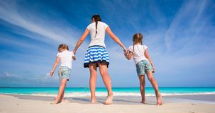 Little kids and happy mother during beach vacation Royalty Free Stock Photo