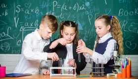 Little kids learn chemistry in school lab. students do biology experiments with microscope. Lab microscope. childrens stock images