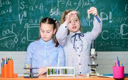 Little kids learning chemistry. Chemistry equipment. students do biology experiments with microscope in lab. Happy stock photos