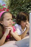 Little Kids Looking At A Laptop Royalty Free Stock Image