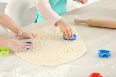 Little kids making biscuits. On table Royalty Free Stock Images