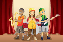 Little kids in music band Royalty Free Stock Photography