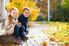 Little kids outdoors at autumn day Royalty Free Stock Photos