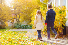 Little kids outdoors in autumn park Stock Images
