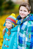 Little kids outdoors in autumn park Royalty Free Stock Photos