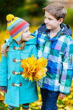 Little kids outdoors in autumn park Royalty Free Stock Photo