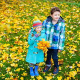 Little kids outdoors in autumn park Stock Image