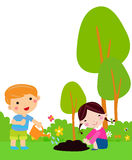 Little kids planting small plant in garden Royalty Free Stock Images