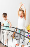 Little kids playing on   bed Stock Photo
