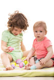 Little kids playing with Easter eggs Royalty Free Stock Photos