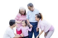 Little kids playing with her family on studio. Picture of little kids playing with her parents and grandparents in the studio, isolated on white background stock photo