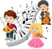 Little kids playing music with piano tone background Stock Photo