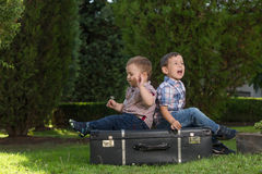 Little kids playing in the park. Two brothers playing in the park Stock Photography