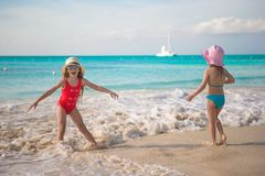 Little kids playing in shallow water at exotic Royalty Free Stock Photos