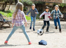 Little kids playing street football outdoors Royalty Free Stock Photos