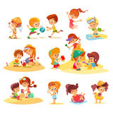 Little kids playing together on beach in groups. Royalty Free Stock Photos