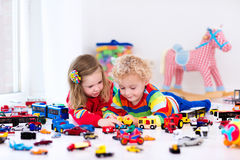 Little kids playing with toy cars Stock Photo